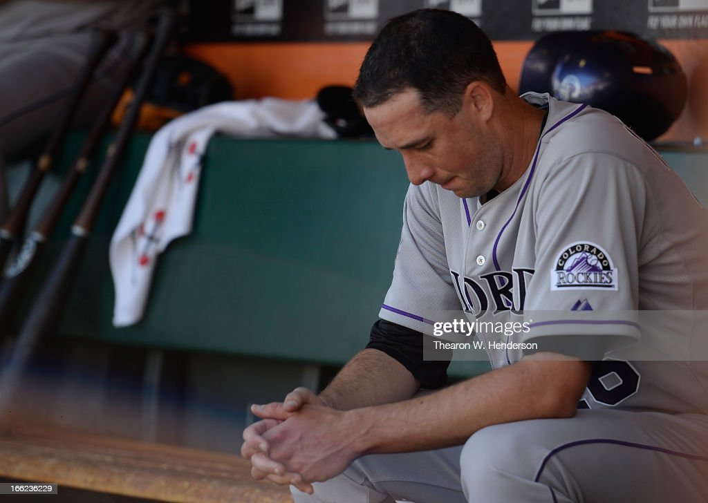 Pitcher <a gi-track='captionPersonalityLinkClicked' href=/galleries/search?phrase=Jeff+Francis&family=editorial&specificpeople=220827 ng-click='$event.stopPropagation()'>Jeff Francis</a> #26 of the Colorado Rockies sits in the dugout after he was taken out of the game against the San Francisco Giants in the bottom of the second inning at AT&T Park on April 10, 2013 in San Francisco, California. The Giants scored seven runs in the first two inning of the game.