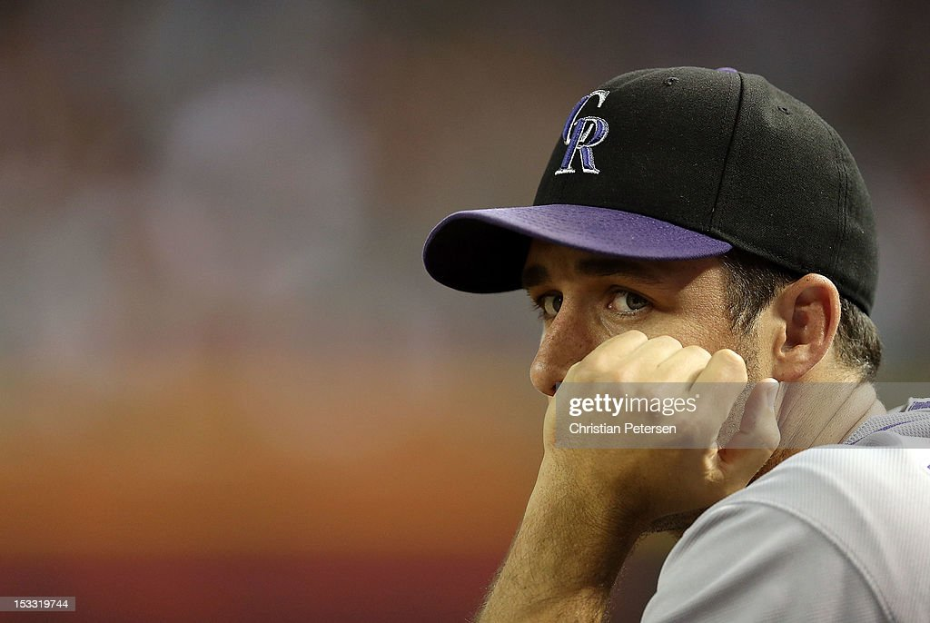 Pitcher Jeff Francis of the Colorado Rockies watches from the dugout during the MLB game against the Arizona Diamondbacks at Chase Field on October 2...