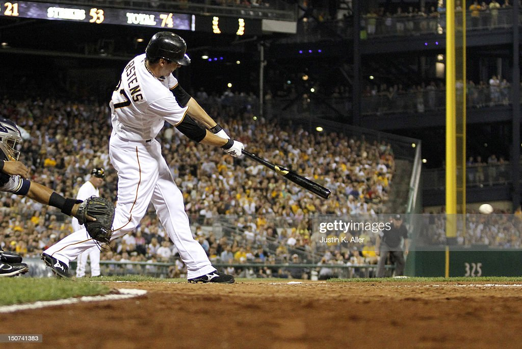 Pitcher <a gi-track='captionPersonalityLinkClicked' href=/galleries/search?phrase=Jeff+Karstens&family=editorial&specificpeople=2362445 ng-click='$event.stopPropagation()'>Jeff Karstens</a> #27 of the Pittsburgh Pirates hits an RBI single in the fifth inning against the Milwaukee Brewers during the game on August 25, 2012 at PNC Park in Pittsburgh, Pennsylvania.