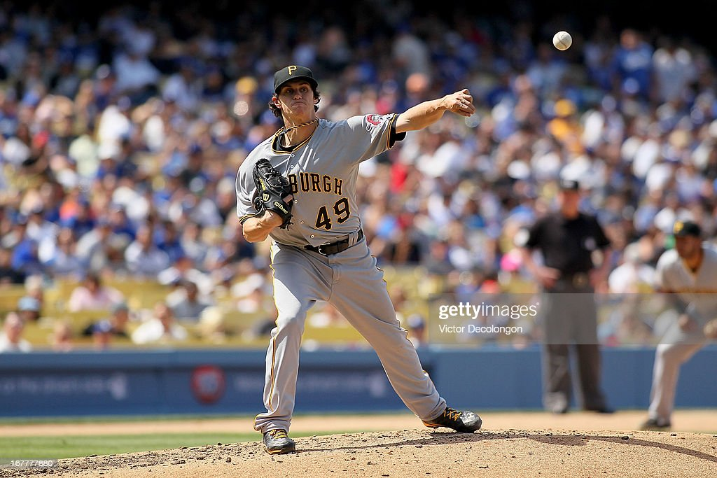 Pitcher Jeff Locke #49 of the Pittsburgh Pirates throws to first base during the MLB game against the Los Angeles Dodgers at Dodger Stadium on April 7, 2013 in Los Angeles, California. The Dodgers defeated the Pirates 6-2.