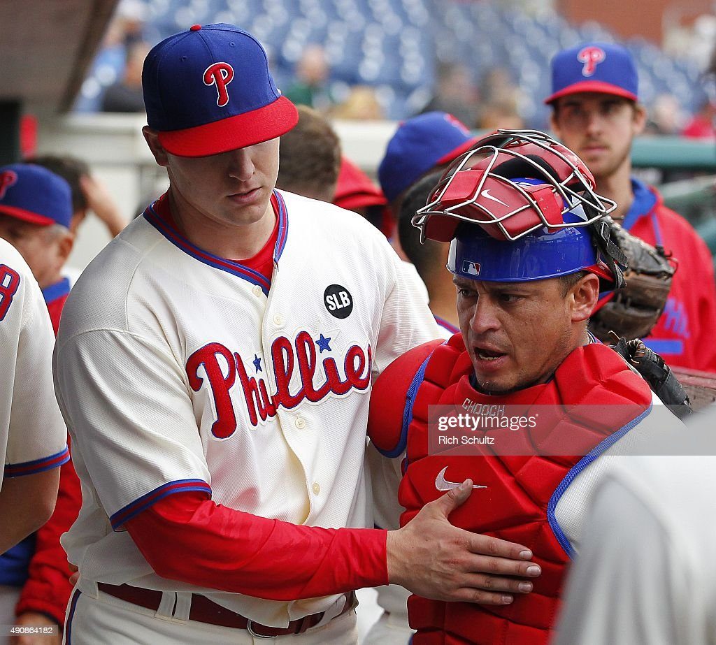 Pitcher Jerad Eickhoff of the Philadelphia Phillies pats catcher Carlos Ruiz on the chest after coming out of the game after the seventh inning...