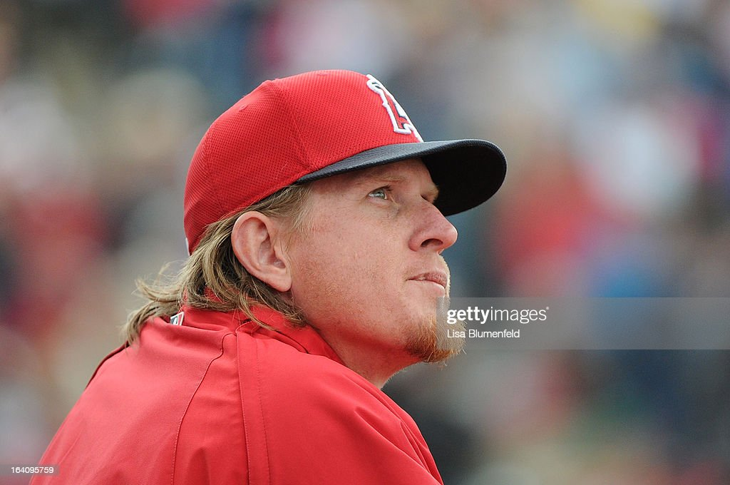 Pitcher <a gi-track='captionPersonalityLinkClicked' href=/galleries/search?phrase=Jered+Weaver&family=editorial&specificpeople=565100 ng-click='$event.stopPropagation()'>Jered Weaver</a> #36 of the Los Angeles Angels of Anaheim looks on during the game against the Colorado Rockies at Tempe Diablo Stadium on March 9, 2013 in Peoria, Arizona.