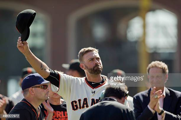 Pitcher Jeremy Affeldt of the San Francisco Giants tips his hat to the crowd during his retirement ceremony before a game against the Colorado...