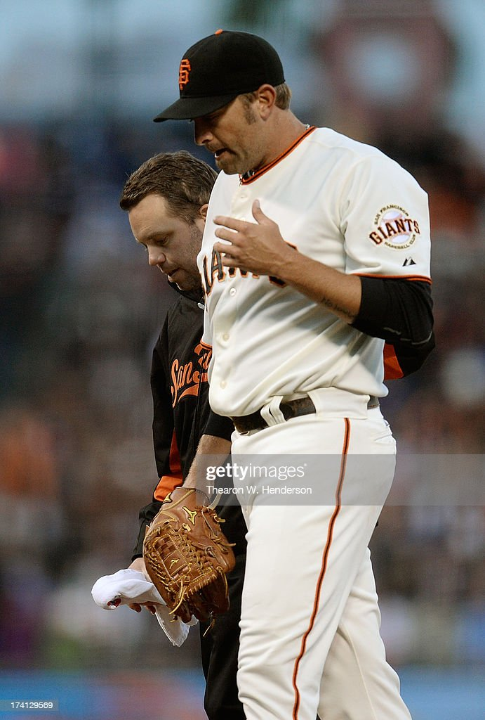 Pitcher <a gi-track='captionPersonalityLinkClicked' href=/galleries/search?phrase=Jeremy+Affeldt&family=editorial&specificpeople=214238 ng-click='$event.stopPropagation()'>Jeremy Affeldt</a> #41 of the San Francisco Giants walks off the field with trainer Mark Gruesbeck after Affeldt injured himself throwing a pitch in the sixth inning against the Arizona Diamondbacks at AT&T Park on July 20, 2013 in San Francisco, California.