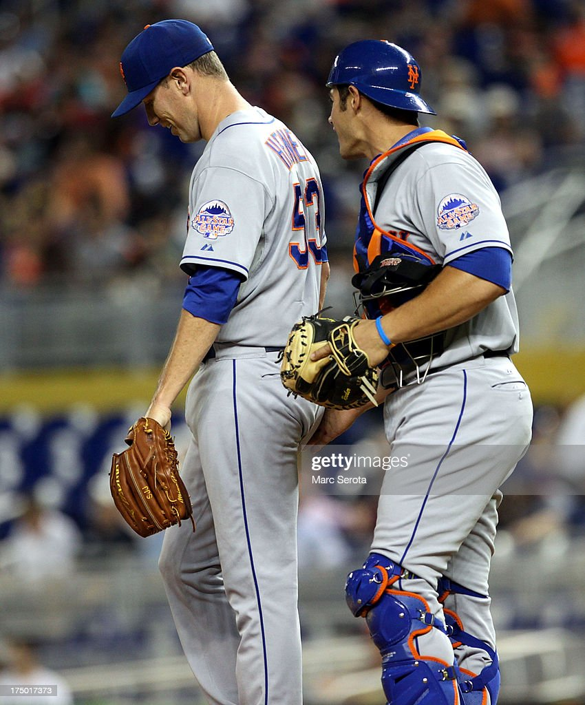 Pitcher Jeremy Hefner #53 of the New York Mets chats with Catcher Anthony Recker #20 during the fourth inning against the Miami Marlins at Marlins Park on July 29, 2013 in Miami, Florida.