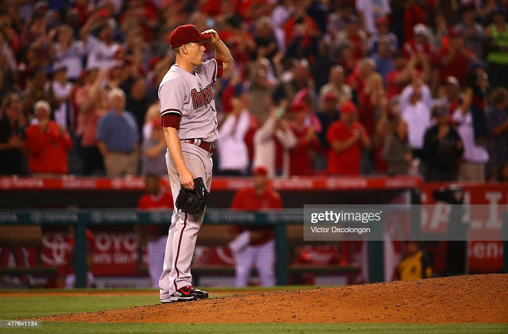 Pitcher <a gi-track='captionPersonalityLinkClicked' href=/galleries/search?phrase=Jeremy+Hellickson&family=editorial&specificpeople=2364859 ng-click='$event.stopPropagation()'>Jeremy Hellickson</a> #58 of the Arizona Diamondbacks reacts after giving up a two-run homerun to Albert Pujols #5 of the Los Angeles Angels of Anaheim (not in photo) in the sixth inning during the MLB game at Angel Stadium of Anaheim on June 16, 2015 in Anaheim, California. The Angels defeated the Diamondbacks 4-1.