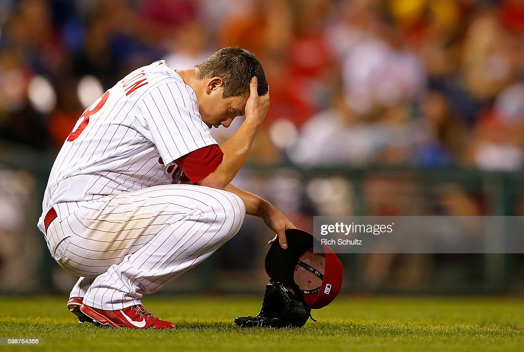 Pitcher Jeremy Hellickson #58 of the Philadelphia Phillies crouches down and reacts after Matt Kemp #27 of the Atlanta Braves hit a three-run home run during the fifth inning of a game at Citizens Bank Park on September 2, 2016 in Philadelphia, Pennsylvania.