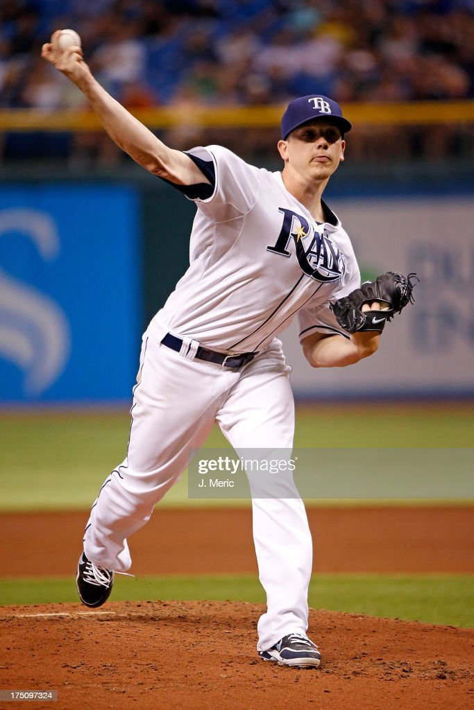 Pitcher <a gi-track='captionPersonalityLinkClicked' href=/galleries/search?phrase=Jeremy+Hellickson&family=editorial&specificpeople=2364859 ng-click='$event.stopPropagation()'>Jeremy Hellickson</a> #58 of the Tampa Bay Rays pitches against the Arizona Diamondbacks during the game at Tropicana Field on July 31, 2013 in St. Petersburg, Florida.
