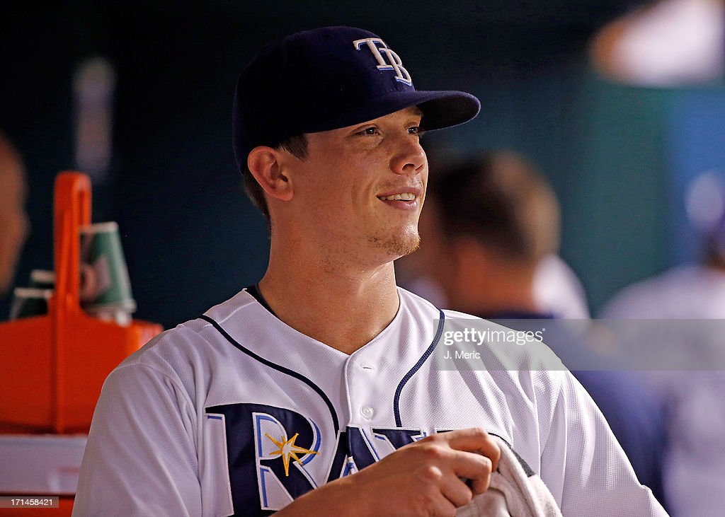 Pitcher <a gi-track='captionPersonalityLinkClicked' href=/galleries/search?phrase=Jeremy+Hellickson&family=editorial&specificpeople=2364859 ng-click='$event.stopPropagation()'>Jeremy Hellickson</a> #58 of the Tampa Bay Rays smiles in the dugout against the Toronto Blue Jays during the game at Tropicana Field on June 24, 2013 in St. Petersburg, Florida.