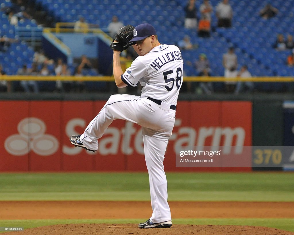 Pitcher Jeremy Hellickson #58 of the Tampa Bay Rays throws in relief against the Baltimore Orioles September 20, 2013 at Tropicana Field in St. Petersburg, Florida. Hellickson was the winning pitcher in the 18-inning game - the longest in Rays history.