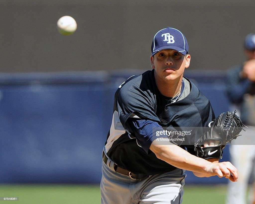 Pitcher <a gi-track='captionPersonalityLinkClicked' href=/galleries/search?phrase=Jeremy+Hellickson&family=editorial&specificpeople=2364859 ng-click='$event.stopPropagation()'>Jeremy Hellickson</a> #58 of the Tampa Bay Rays throws in relief against the New York Yankees March 5, 2010 at the George M. Steinbrenner Field in Tampa, Florida.