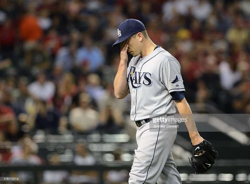 Pitcher <a gi-track='captionPersonalityLinkClicked' href=/galleries/search?phrase=Jeremy+Hellickson&family=editorial&specificpeople=2364859 ng-click='$event.stopPropagation()'>Jeremy Hellickson</a> #58 walks to the dugout after being relieved in the fifth inning against the Arizona Diamondbacks at Chase Field on August 6, 2013 in Phoenix, Arizona. The Diamondbacks defeated the Rays 6-1.