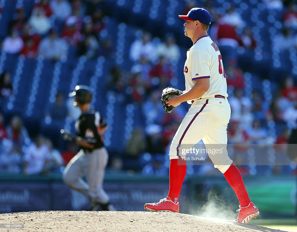 Pitcher <a gi-track='captionPersonalityLinkClicked' href=/galleries/search?phrase=Jeremy+Horst&family=editorial&specificpeople=7510518 ng-click='$event.stopPropagation()'>Jeremy Horst</a> #47 of the Philadelphia Phillies walks up the mound as <a gi-track='captionPersonalityLinkClicked' href=/galleries/search?phrase=Justin+Ruggiano&family=editorial&specificpeople=4536828 ng-click='$event.stopPropagation()'>Justin Ruggiano</a> #20 of the Miami Marlins rounds third base after hitting a two-run home run during the ninth inning in a MLB baseball game on May 5, 2013 at Citizens Bank Park in Philadelphia, Pennsylvania.