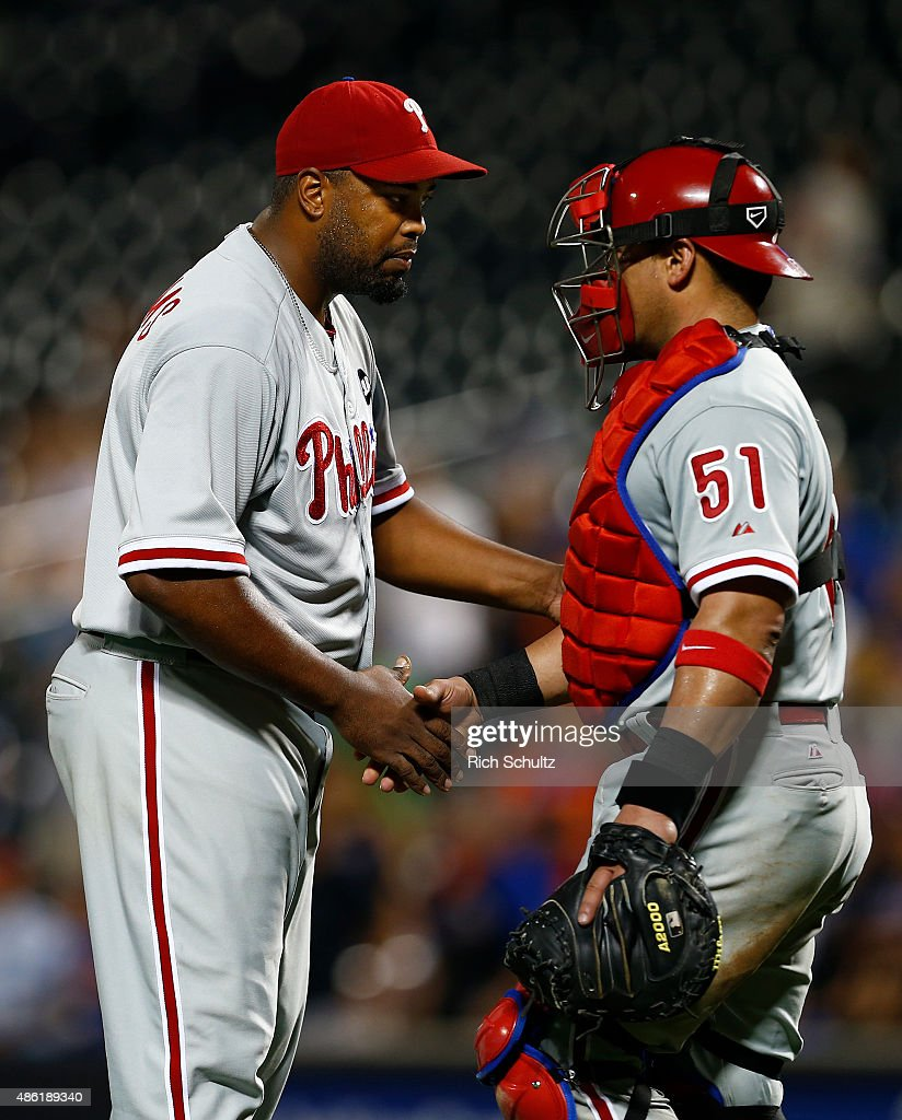 Pitcher Jerome Williams #31 is congratulated by catcher <a gi-track='captionPersonalityLinkClicked' href=/galleries/search?phrase=Carlos+Ruiz+-+Baseball+Player&family=editorial&specificpeople=216605 ng-click='$event.stopPropagation()'>Carlos Ruiz</a> #51 after the Phillies defeated the New York Mets 14-8 on September 1, 2015 at Citi Field in the Flushing neighborhood of the Queens borough of New York City.