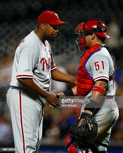Pitcher Jerome Williams is congratulated by catcher Carlos Ruiz after the Phillies defeated the New York Mets 148 on September 1 2015 at Citi Field...