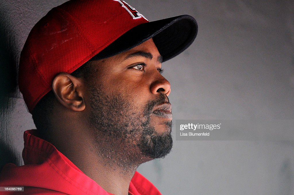Pitcher <a gi-track='captionPersonalityLinkClicked' href=/galleries/search?phrase=Jerome+Williams+-+Baseball+Player&family=editorial&specificpeople=15260950 ng-click='$event.stopPropagation()'>Jerome Williams</a> #57 of the Los Angeles Angels of Anaheim looks on during the game against the Colorado Rockies at Tempe Diablo Stadium on March 9, 2013 in Peoria, Arizona.