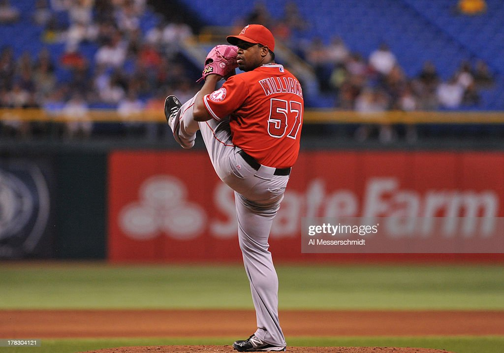 Pitcher <a gi-track='captionPersonalityLinkClicked' href=/galleries/search?phrase=Jerome+Williams+-+Basketball+Player&family=editorial&specificpeople=202056 ng-click='$event.stopPropagation()'>Jerome Williams</a> #57 of the Los Angeles Angels of Anaheim of Anaheim throws in relief against the Tampa Bay Rays August 28, 2013 at Tropicana Field in St. Petersburg, Florida. The Rays won 4 - 1.