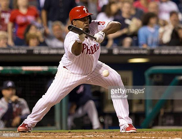 Pitcher Jerome Williams of the Philadelphia Phillies lays downs a sacrifice bunt in the bottom of the fifth inning against the Atlanta Braves on...