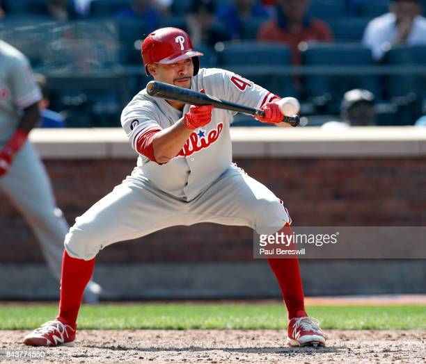 Pitcher Jesen Therrien of the Philadelphia Phillies bunts in an MLB baseball game against the New York Mets on September 4 2017 at CitiField in the...