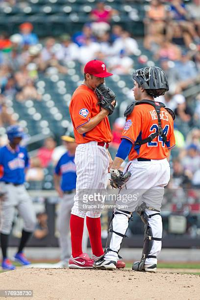Pitcher Jesse Biddle of the United States talks with catcher Austin Hedges during the game on July 14 2013 at Citi Field in the Flushing neighborhood...