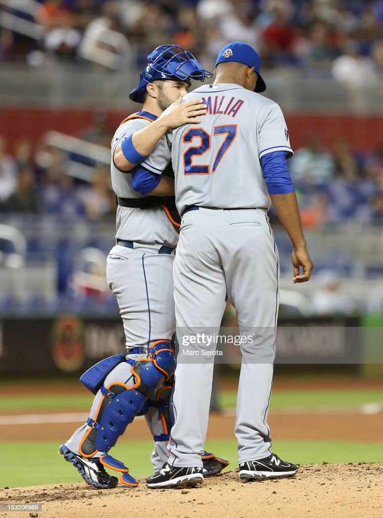 Pitcher Jeurys Familia #27 of the New York Mets chats with catcher Kelly Stoppach #6 against the Miami Marlins at Marlins Park on October 1, 2012 in Miami, Florida.