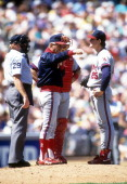 Pitcher Jim Abbott of the California Angels is taken out of the game as manager Doug Radar calls for a reliever during an MLB game against the...