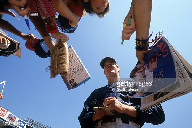 Pitcher Jim Abbott of the California Angels signs autographs before an MLB game circa 1989 at Anaheim Stadium in Anaheim California