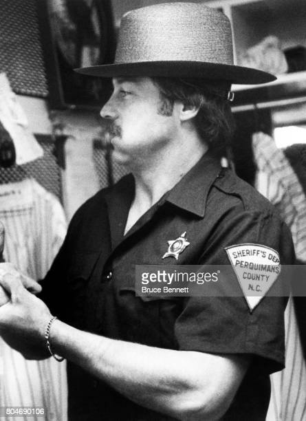 Pitcher Jim 'Catfish' Hunter of the New York Yankees comes dressed in a Sheriff's Department uniform from Perquiman's County North Carolina in which...