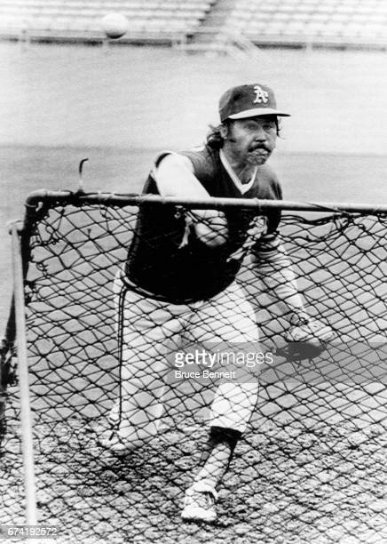 Pitcher Jim 'Catfish' Hunter of the Oakland Athletics throws batting practice the day before Game 1 of the 1974 World Series on October 11 1974 at...