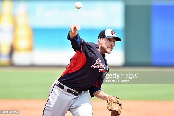 Pitcher Jim Johnson of the Atlanta Braves pitches during a spring training game against the Pittsburgh Pirates on March 26 2015 at McKechnie Field in...