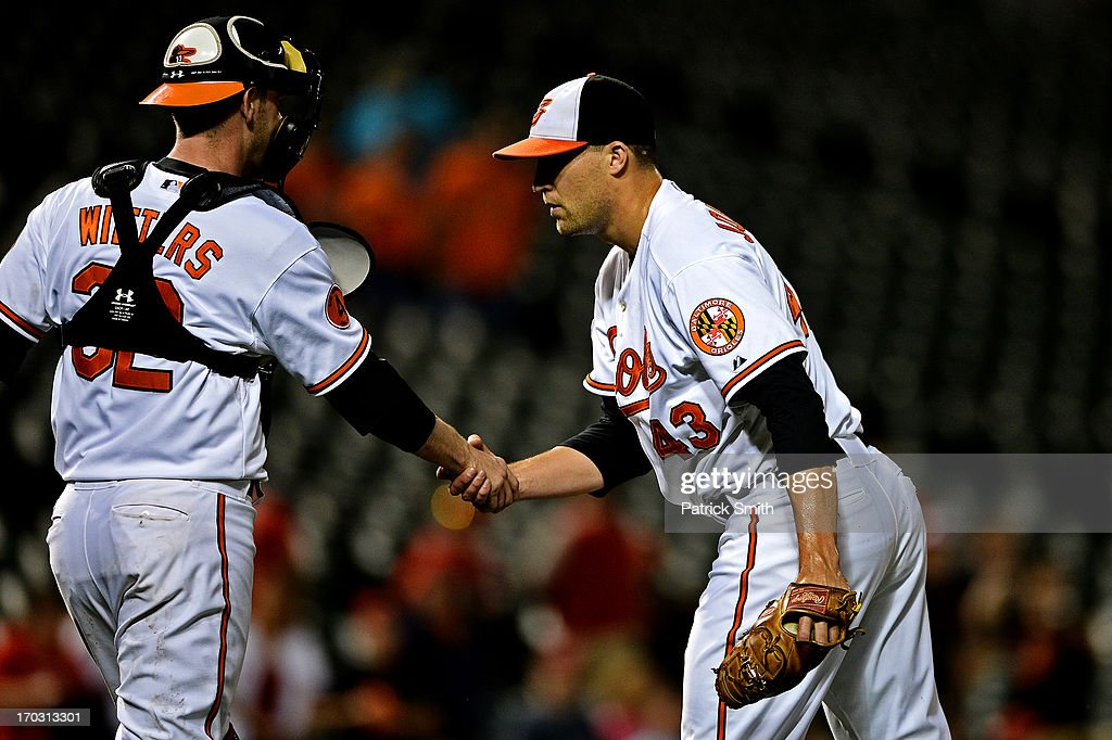Pitcher Jim Johnson #43 of the Baltimore Orioles celebrates with teammate catcher <a gi-track='captionPersonalityLinkClicked' href=/galleries/search?phrase=Matt+Wieters&family=editorial&specificpeople=4498276 ng-click='$event.stopPropagation()'>Matt Wieters</a> #32 after defeating the Los Angeles Angels of Anaheim at Oriole Park at Camden Yards on June 10, 2013 in Baltimore, Maryland. The Baltimore Orioles won, 4-3.