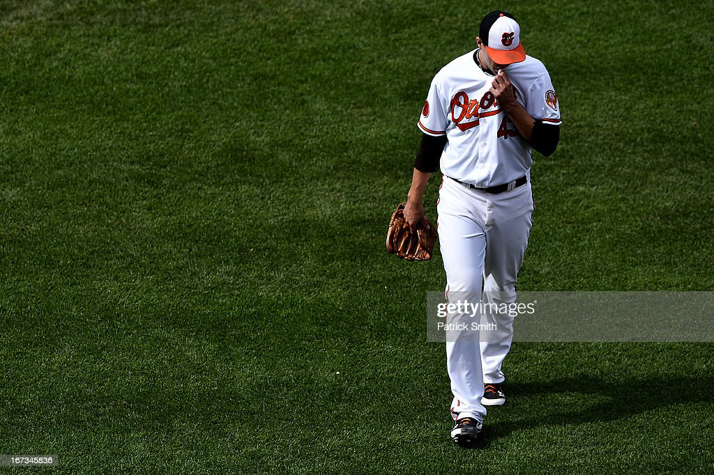 Pitcher Jim Johnson #43 of the Baltimore Orioles is relieved after walking batter Maicer Izturis #3 of the Toronto Blue Jays (not pictured) with the bases loaded and giving up the winning run in the eleventh inning against the Toronto Blue Jays at Oriole Park at Camden Yards on April 24, 2013 in Baltimore, Maryland. The Toronto Blue Jays won, 6-5.