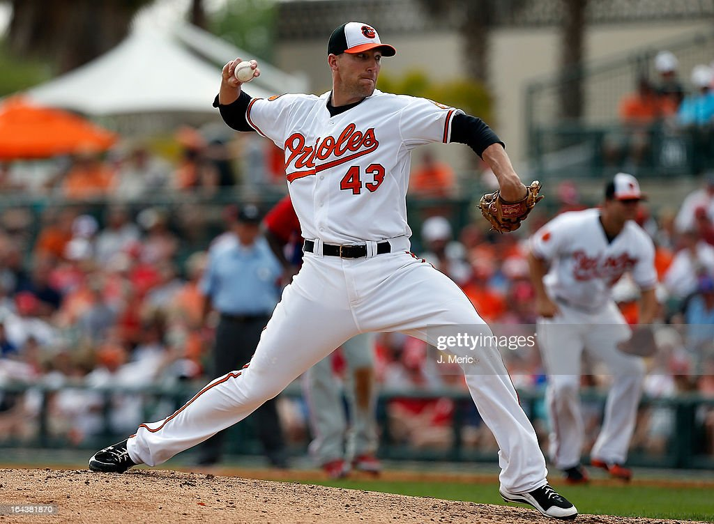 Pitcher Jim Johnson #43 of the Baltimore Orioles pitches against the Philadelphia Phillies during a Grapefruit League Spring Training Game at Ed Smith Stadium on March 23, 2013 in Sarasota, Florida.