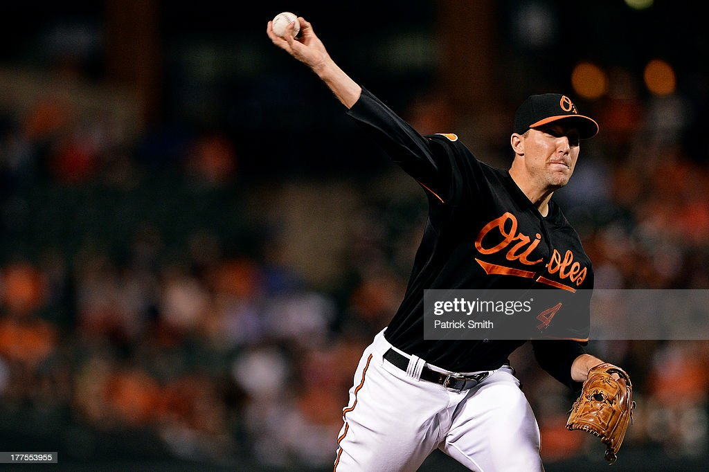 Pitcher Jim Johnson #43 of the Baltimore Orioles works the ninth inning against the Oakland Athletics at Oriole Park at Camden Yards on August 23, 2013 in Baltimore, Maryland. The Baltimore Orioles won, 9-7.