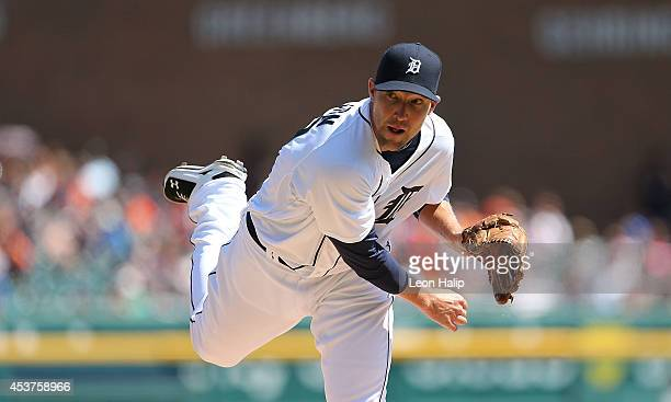 Pitcher Jim Johnson of the Detroit Tigers makes his first appearance as a Detroit Tiger during the sixth inning of the game against the Seattle...