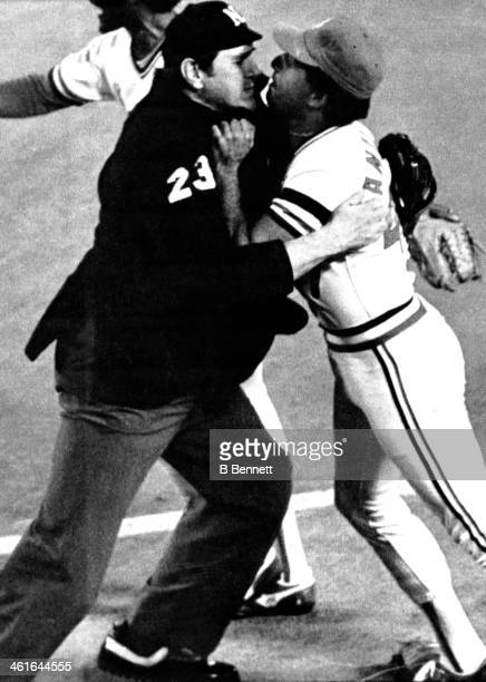 Pitcher Joaquin Andujar of the St Louis Cardinals is held by umpire Bill Haller as Andujar has words with Jim Gantner of the Milwaukee Brewers during...
