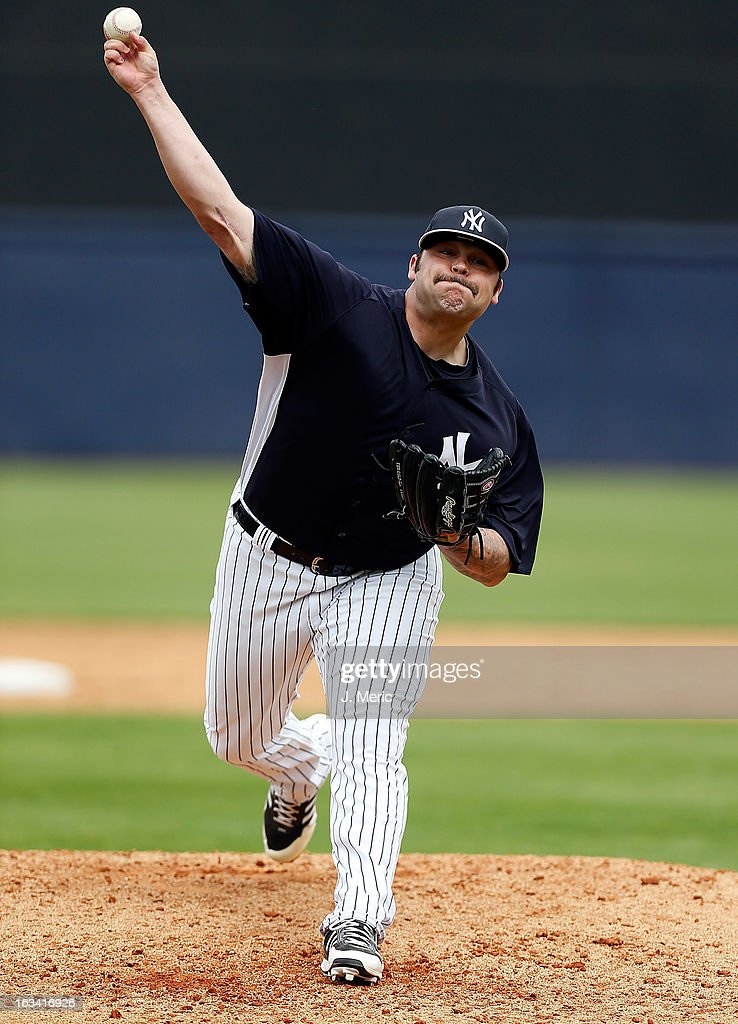 Pitcher <a gi-track='captionPersonalityLinkClicked' href=/galleries/search?phrase=Joba+Chamberlain&family=editorial&specificpeople=4391682 ng-click='$event.stopPropagation()'>Joba Chamberlain</a> #62 of the New York Yankees pitches against the Atlanta Braves during a Grapefruit League Spring Training Game at George M. Steinbrenner Field on March 9, 2013 in Tampa, Florida.