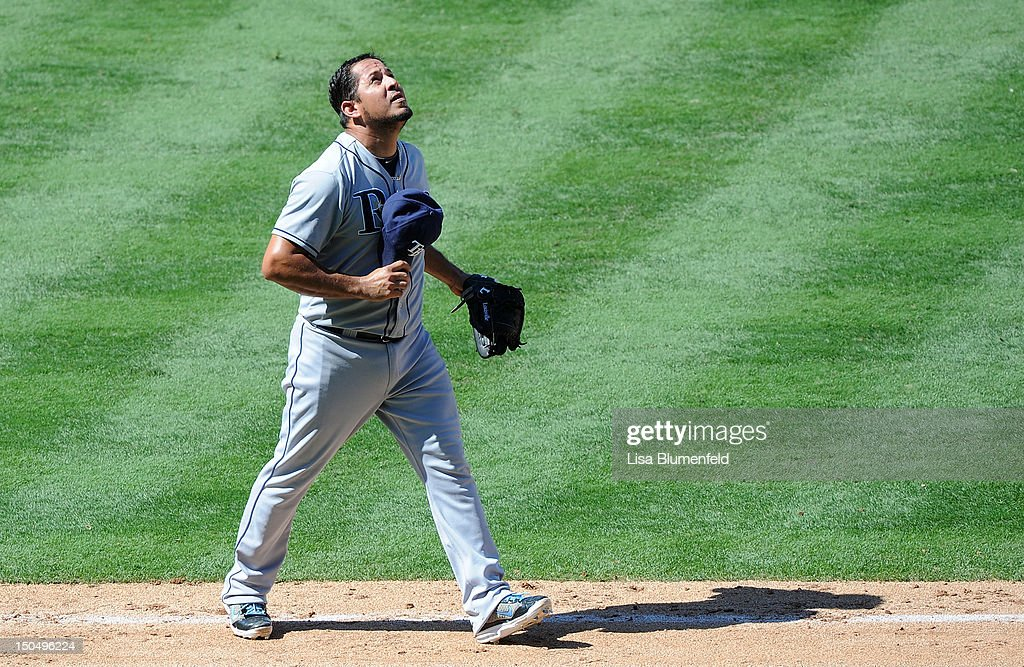 Pitcher <a gi-track='captionPersonalityLinkClicked' href=/galleries/search?phrase=Joel+Peralta&family=editorial&specificpeople=581506 ng-click='$event.stopPropagation()'>Joel Peralta</a> #62 of the Tampa Bay Rays celebrates during the game against the Los Angeles Angels of Anaheim at Angel Stadium of Anaheim on August 19, 2012 in Anaheim, California.