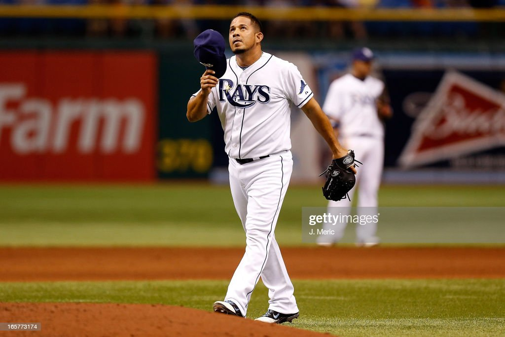 Pitcher <a gi-track='captionPersonalityLinkClicked' href=/galleries/search?phrase=Joel+Peralta&family=editorial&specificpeople=581506 ng-click='$event.stopPropagation()'>Joel Peralta</a> #62 of the Tampa Bay Rays celebrates victory over the Cleveland Indians at Tropicana Field on April 5, 2013 in St. Petersburg, Florida.