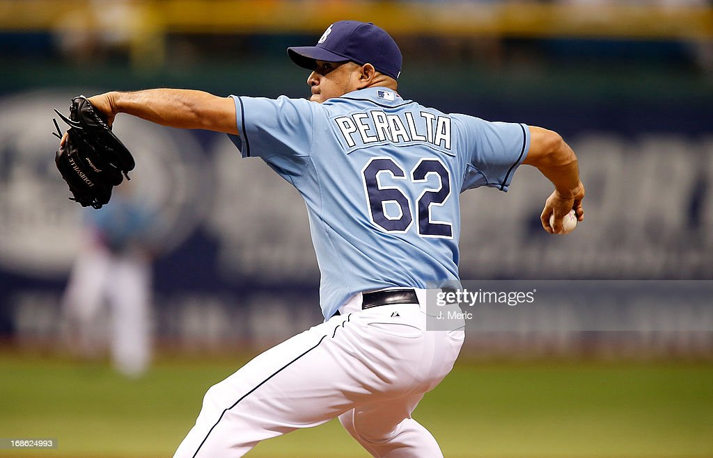 Pitcher <a gi-track='captionPersonalityLinkClicked' href=/galleries/search?phrase=Joel+Peralta&family=editorial&specificpeople=581506 ng-click='$event.stopPropagation()'>Joel Peralta</a> #62 of the Tampa Bay Rays pitches against the San Diego Padres during the game at Tropicana Field on May 12, 2013 in St. Petersburg, Florida.
