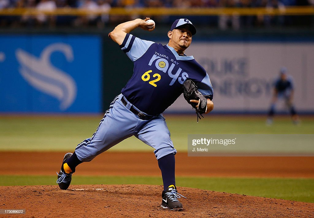 Pitcher <a gi-track='captionPersonalityLinkClicked' href=/galleries/search?phrase=Joel+Peralta&family=editorial&specificpeople=581506 ng-click='$event.stopPropagation()'>Joel Peralta</a> #62 of the Tampa Bay Rays pitches the eighth inning against the Chicago White Sox at Tropicana Field on July 6, 2013 in St. Petersburg, Florida.