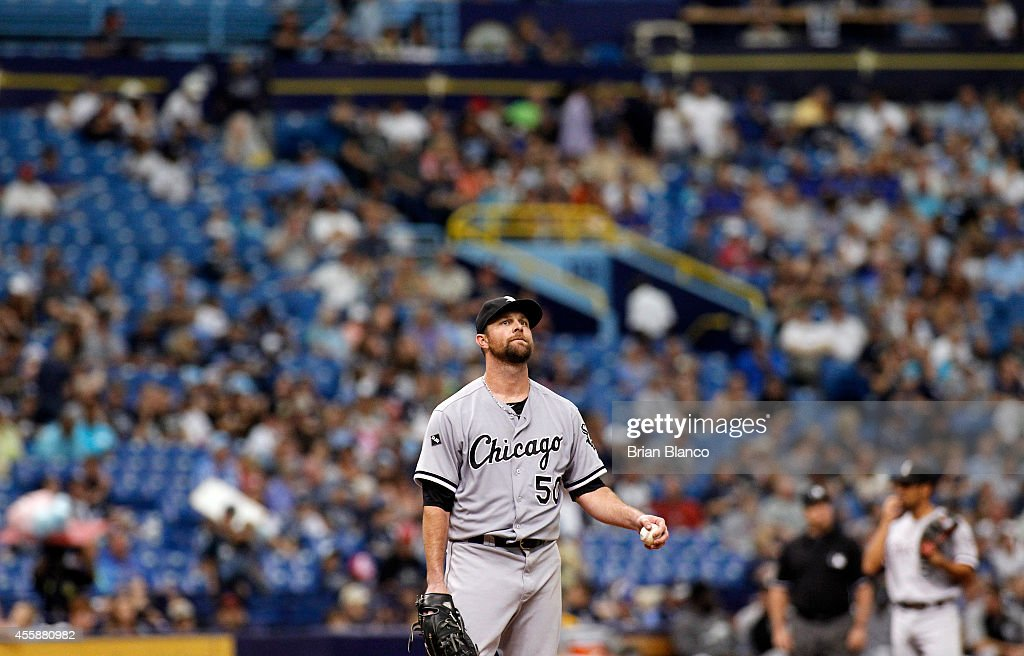 Pitcher <a gi-track='captionPersonalityLinkClicked' href=/galleries/search?phrase=John+Danks&family=editorial&specificpeople=835613 ng-click='$event.stopPropagation()'>John Danks</a> #50 of the Chicago White Sox reacts on the mound after walking Curt Casali of the Tampa Bay Rays during the sixth inning of a game on September 21, 2014 at Tropicana Field in St. Petersburg, Florida.
