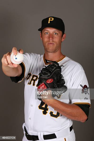 Pitcher John Holdzkom of the Pittsburgh Pirates poses for a portrait on photo day on February 26 2015 at Pirate City in Bradenton Florida