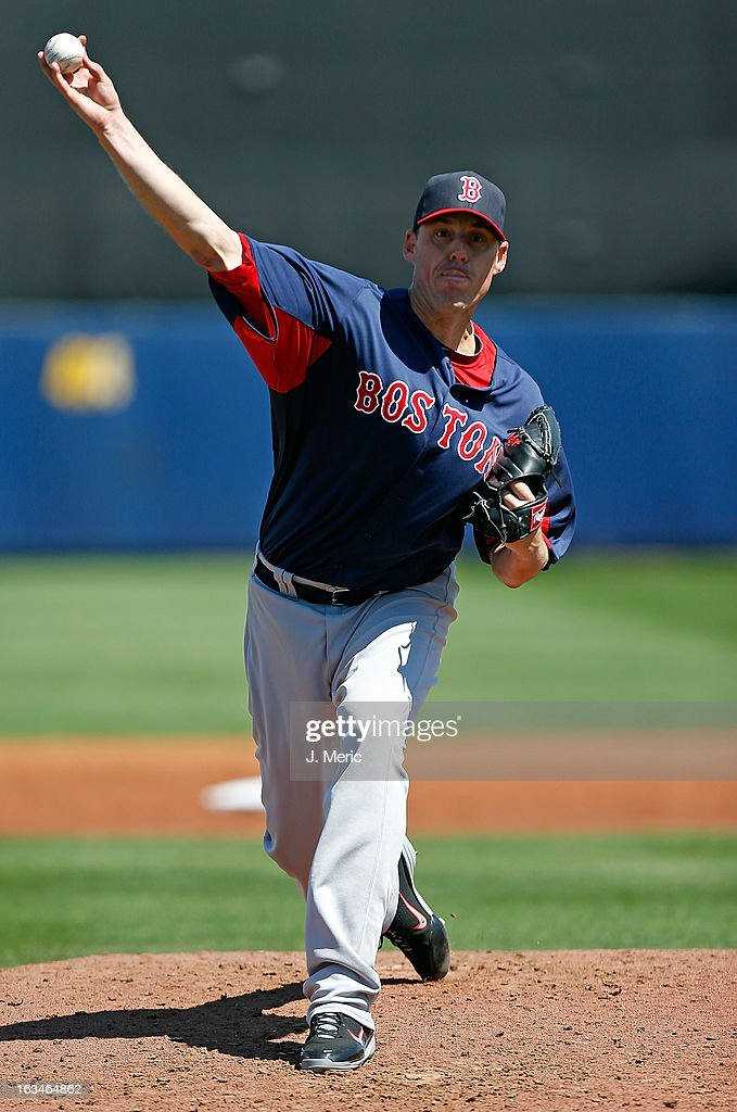 Pitcher <a gi-track='captionPersonalityLinkClicked' href=/galleries/search?phrase=John+Lackey&family=editorial&specificpeople=171533 ng-click='$event.stopPropagation()'>John Lackey</a> #41 of the Boston Red Sox pitches against the Tampa Bay Rays during a Grapefruit League Spring Training Game at the Charlotte Sports Complex on March 10, 2013 in Port Charlotte, Florida.