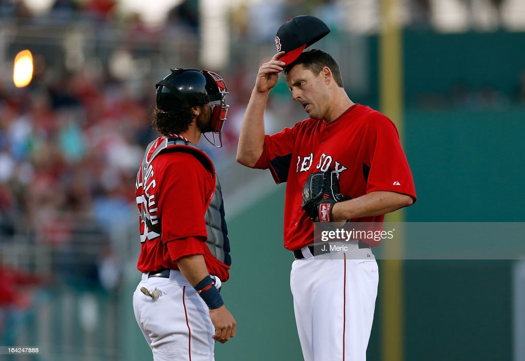 Pitcher <a gi-track='captionPersonalityLinkClicked' href=/galleries/search?phrase=John+Lackey&family=editorial&specificpeople=171533 ng-click='$event.stopPropagation()'>John Lackey</a> #41 of the Boston Red Sox talks with catcher <a gi-track='captionPersonalityLinkClicked' href=/galleries/search?phrase=Jarrod+Saltalamacchia&family=editorial&specificpeople=836404 ng-click='$event.stopPropagation()'>Jarrod Saltalamacchia</a> #39 during a Grapefruit League Spring Training Game against the Philadelphia Phillies at JetBlue Park on March 21, 2013 in Fort Myers, Florida.