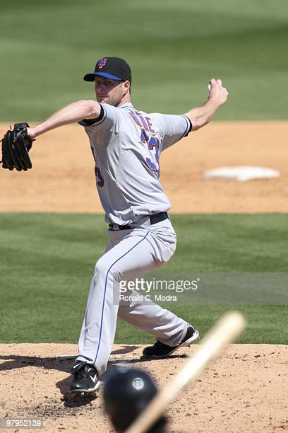 Pitcher John Maine of the New York Mets pitches during a game against the Florida Marlins at Roger Dean Stadium on March 14 2010 in Jupiter Florida