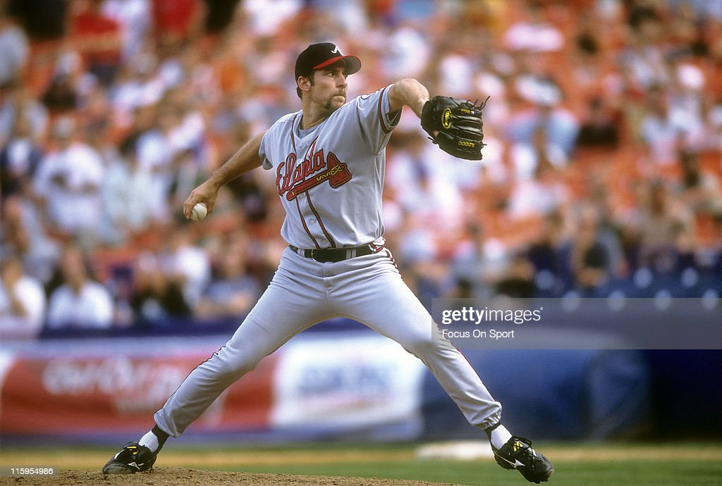 Pitcher John Smoltz #29 of the Atlanta Braves pitches against the New York Mets during a Major League Baseball game circa 2002 at Shea Stadium in the Queens borough of New York City. Smoltz played for the Braves from 1988-2008.