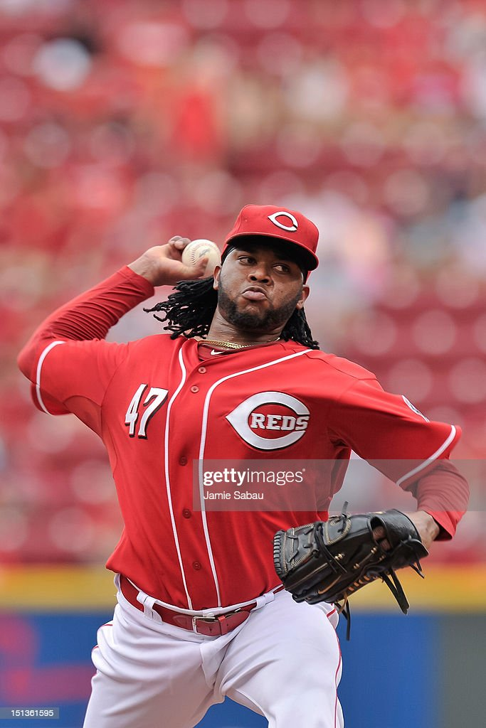 Pitcher <a gi-track='captionPersonalityLinkClicked' href=/galleries/search?phrase=Johnny+Cueto&family=editorial&specificpeople=4921735 ng-click='$event.stopPropagation()'>Johnny Cueto</a> #47 of the Cincinnati Reds pitches against the Philadelphia Phillies at Great American Ball Park on September 3, 2012 in Cincinnati, Ohio.