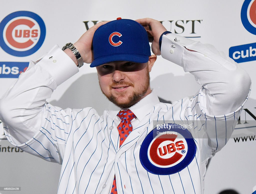 Pitcher <a gi-track='captionPersonalityLinkClicked' href=/galleries/search?phrase=Jon+Lester&family=editorial&specificpeople=832746 ng-click='$event.stopPropagation()'>Jon Lester</a> puts on a Cubs hat during an introduction press conference by the Chicago Cubs on December 15, 2014 in Chicago, Illinois.