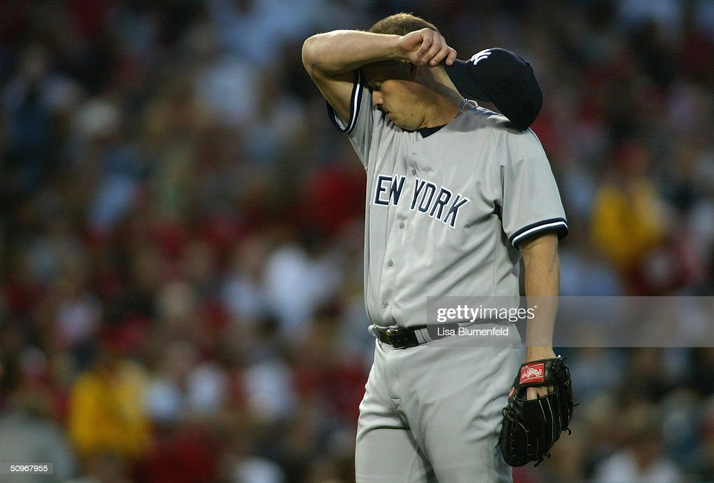 Pitcher Jon Lieber #22 of the New York Yankees cleans his forehead during the game against the Anaheim Angels at Angel Stadium on May 19, 2004 in Anaheim, California. The Yankees won 4-2.